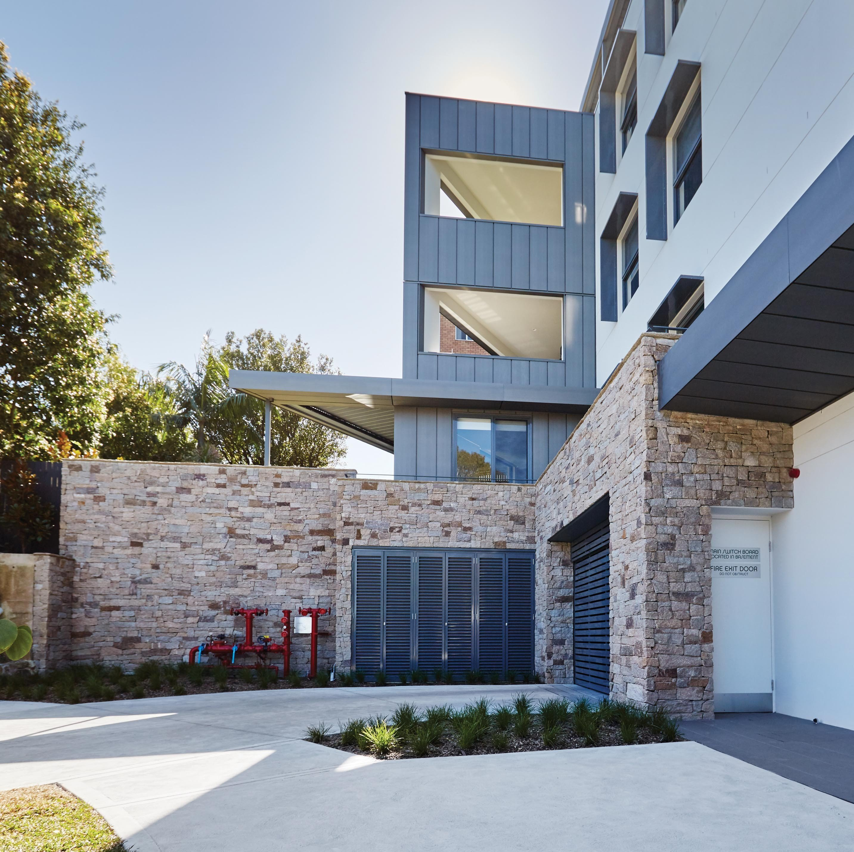 Wall-Cladding-and-Stacked-Stones Hero Estate